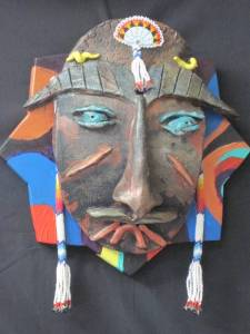 SOLD Shaman Eyes, raku and multi-media, $150.00